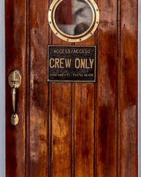 brown crew only door with porthole